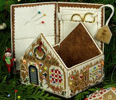 Victoria Sampler cross stitch Gingerbread House. Site has stitch animation and free patterns.
