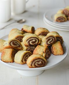 (TESTED & PERFECTED RECIPE) A much-loved Jewish holiday treat rugelach are miniature pastries posing as cookies. These chocolate rugelach are made by rolling a buttery flaky dough around a sweet chocolate filling. Chocolate Cream Cheese, Chocolate Filling, Chocolate Croissant, Chocolate Pastry, Chocolate Cookies, Tea Cakes, Scones, Cookie Recipes, Dessert Recipes