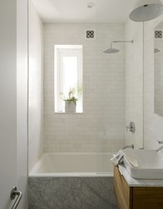 Compact marble tiled bath in Jacqueline-Schmidt and David Friedlander's 675-square-foot Brooklyn quarters, Matthew-Williams-photo   Remodelista