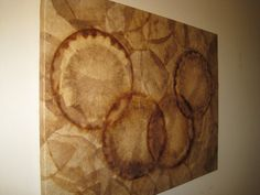 This artwork is designed with recycled coffee filters. The coffee filters are in their natural stained colors. This wall decor is rustic, ecofriendly and adds ambience to any room. The coffee filters are dried, cleaned and cut one by one. A coat of varnish gives protection and durability. This wall decor is truly one-of-a-kind