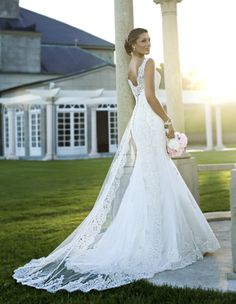 Love dramatic backs and lace?  Stop by to see this one in store with its detachable lace train!