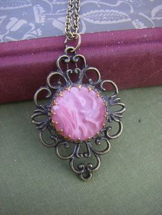 awesome idea, button turned into gorgeous pendant!