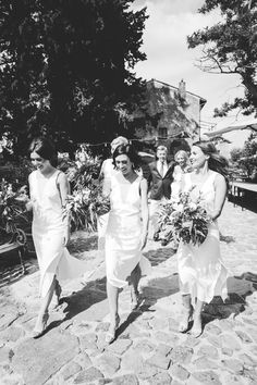 Amazing bridemaids wearing white dresses. It's been a very elegant ceremony in church followed by dinner on terrace of Massello.