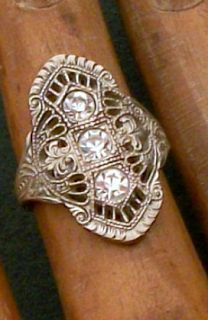Vintage Art Deco Ring. Filigree with Brilliants: $80.  Via Diamonds in the Library.