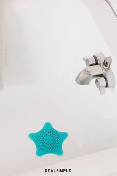 10 Under-$20 Ways to Get Your Home Cleaner and Tidier for Cheap | To help you clean the shower drain less often, order an effective shower drain cover that will help stop hair and soap scum from creating clogs. This cute, starfish-shaped drain cover is top-rated, and costs less than 10 bucks. #declutter #organizationtips #realsimple #declutterideas #howtoclean #homeorganization