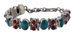 Sterling Silver Coral Turquoise Bracelet, # 5 Turquoise Jewelry Shop. $129.99. Handmade in Nepal. Made from Sterling Silver,Coral, and Turquoise. Width: 0.4 Inch. This bracelet has the nicest craftsmanship.. Bracelet Length: 8 Inches