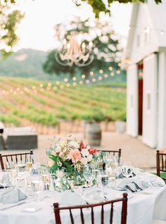 Protea Centerpiece and Hanging Chandeliers | Danielle Poff Photography | Natural Elegance at a Southern California Vineyard