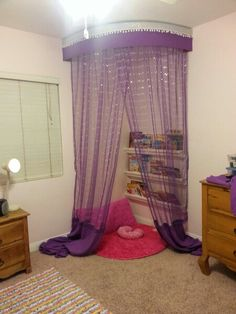 DIY-Children's room reading nook. Made with curtains, sheers, and plastic rain gutters for book shelves.