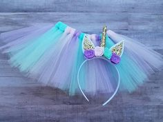Beautiful unicorn tutu set includes tutu and headband! Tutu Colors include :: Lavender Light pink Teal/mint Headband colors :: Gold Light pink Lavender Teal/mint Perfect for birthday parties Photography Smash cake sessions Halloween Dress up