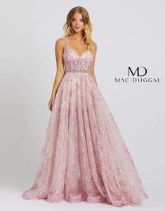 Mac Duggal is a rose floral illusion romper that has spaghetti straps, a v-neckline, and has embellishements throughout the gown. This romper that doubles as a gown has floral embroidery and is perfect for your nect occasion! Long Romper, Romper Dress, Romper Pants, Mac Duggal, Prom Long, Spaghetti Strap Dresses, Spaghetti Straps, Homecoming Dresses, Dress Prom