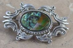 Exquisite vintage shell brooch signed vintage jewellery from Exquisite UK. 1970s dated abalone shell brooch.