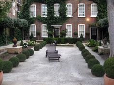 gravel + boxwood + ivy + terracotta + hydrangea (good foundation planting) but that lounger looks lonely!