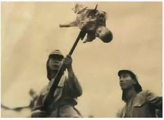 "Japanese soldiers play with a ""doll""-- a human baby impaled with a bayonet. Bestiality at its most brutal. I wouldn't have hesitated to shoot both of these bastards in places that would have made them die a slow death."