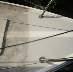 Pressure washing a very neglected sailboat.