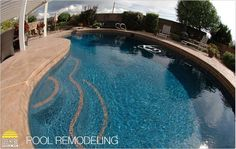 This pool is absolutely gorgeous! I would love to have a pool that looks like this in my yard! I especially like the decorative concrete around the pool. It is so much more lively and nice looking than regular concrete would be. If I ever got a pool I would for sure want decorative concrete to go around it. I wonder if my husband likes the concrete in this picture. I will have to show it to him and see what he thinks. Emily Smith