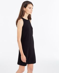 "Pique performance: crafted in knit pique with the perfect hint of stretch, this subtly sultry sheath is a summer must. Jewel neck. Sleeveless. Hidden back zipper with hook-and-eye closure. 19"" from natural waist."