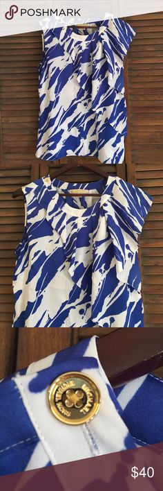 NWOT Michael Kors Sleeveless Top 🚫 no trades 🚫 NWOT. Size 10. Never worn. Only tried on & then I never reached for it. Super cute! Blue and white sleeveless Blouse with ruffle detail on left shoulder. 100% Polyester. OFFERS ARE WELCOMED 😊💕 Michael Kors Tops Tank Tops