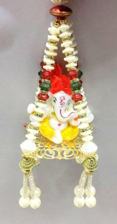This is a ganapati hanging. Would work great to hang at home or in the car. Size - 8 inches from top to bottom. 4 inches wide at the base. Diwali Diy, Diwali Craft, Diwali Designs, Diwali Decoration Items, Daycare Teacher Gifts, Door Hanging Decorations, Acrylic Rangoli, Ganpati Bappa, Krishna Art