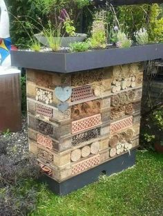 Beautiful use of natural materials makes this insect hotel/raised garden bed a work of art!