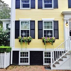 In addition, it will likely last so long as the house is standing so future homeowners might have to handle the choices that you create. An yellow paint colors exterior is among my favored trends for your house's outside. Yellow House Exterior, Exterior Paint Colors For House, Paint Colors For Home, Exterior Colors, Paint Colours, Grey Exterior, Cottage Exterior, House Shutters, Black Shutters