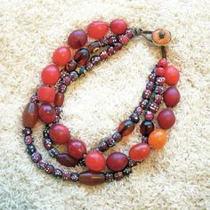 "Twiga Gallery Designs | 'Purpose'  Necklace.  Venetian ""White Heart Trade Beads"", North African Amber, Tibetan Dzi Beads African Copal Amber & red and orange Dogan Trade glass beads 