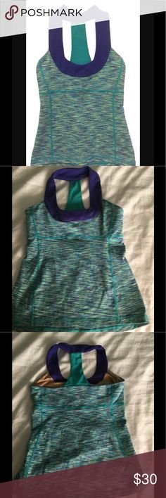 Lululemon scoop neck tank 8 Beautiful lululemon tank, in purple and teal. Size 8, built in bra. Doesn't come with breast cups. Pre-owned gently used. Doesn't come with tag, I cut the tags off all my workout gear lululemon athletica Other
