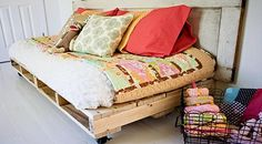 DIY Daybed made with pallets.  Paint and put on castors. Cover mattress with waterproof material for outdoors.