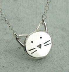 Cat Necklace -  in sterling silver by Kathryn Riechert. $62.00, via Etsy.