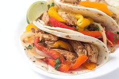 Tender pork, shredded and then cooked with a variety of bell peppers and onions! The perfect weeknight or weekend meal!