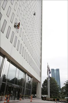 One Government Center Window Cleaners: Israel Ibarra, left, and his brother Miguel Ibarra of Clearview Cleaning Contractors LLC of Cleveland...