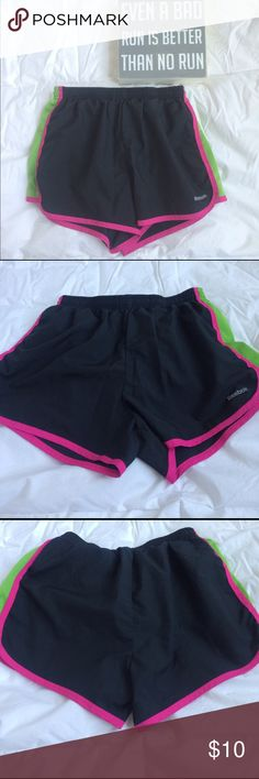 •• REEBOK RUNNING SHORTS •• Black running shorts with pink and green stripes on the sides from Reebok. Has a built in liner. Only worn a few times and still in great condition. Reebok Shorts