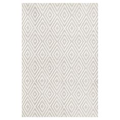 Showcasing a hand-woven diamond motif in grey and white, this eye-catching indoor/outdoor rug brings an elegant touch to your living room or patio decor.