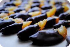 Candied Orange Slices dipped in dark chocolate - http://gardenmama.typepad.com/my_weblog/food_and_drink/page/6/