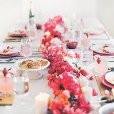 Ditch the traditional floral centerpiece and try a floral runner. Use florals from your backyard - like the bougainvillea!