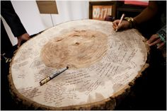 """Photo Credit: Lora Ayers. I like this idea of a log table """"guest book"""""""