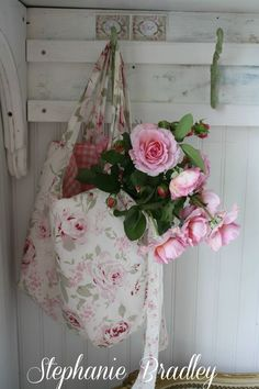 I love the thought of sneaking a vase into that bag and keeping the roses there.  Maybe the cat would actually leave my flowers alone for once.  Nahhh...what am I thinking?!