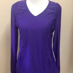 Athleta Long Sleeve Top Purple, long sleeve athletic top. The sleeves have thumb holes for comfort when you're running or walking. The back has a pretty pattern Athleta Tops Tees - Long Sleeve