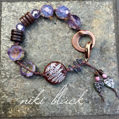 Made this bracelet using Czech glass beads, glass beads, wood beads and more.  --Niki Black