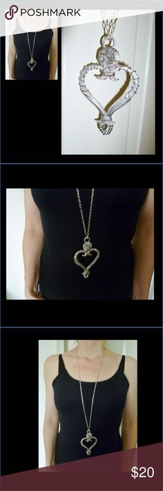 Torrente baroque heart pendant necklace Beautiful metal pendant. I am selling it with a simple chain, but you can use another one, like a silk or a leather cord. Pendant dimensions: 4'' x 2 1/2'' x 1/4'' Torrente Paris Jewelry Necklaces