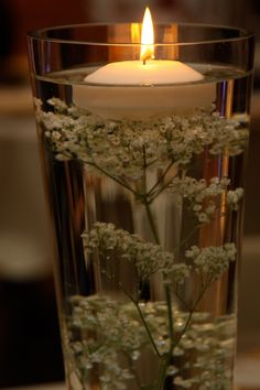 Simple and pretty centerpieces with submerged baby's breath. Cute and cheap. Could put blue and orange candles to keep with the theme :)