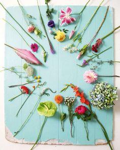 Clockwise (start top left): lysianthus (pink), lysianthus (purple), garden rose, stargazer lily, snow on the mountain, protea, hanekam, penny stem, sea holly, dahlia, bougainvillea, sword lily, paeonia, silver brunia, dahlia, anthurium, veronica, crocosmi