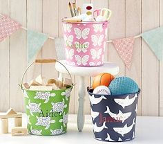 Shark storage bucket for nautical themed nursery or toddler room.