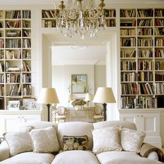 Elegant white library with a comfortable and beautiful couch