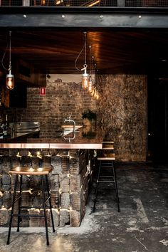 Reclaimed timber boards and sections of mesh fencing feature in this ambient industrial style bar.