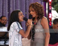Bobbi Kristina Brown and Whitney Houston perform in Central Park on September 1, 2009 in New York City.