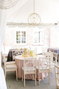 Blush Linen with White Washed Circle Chairs + Gail Chandeliers | Modern Charleston Wedding at The Historic Rice Mill by Charleston Wedding Planner ELM Events