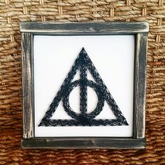 Check out this item in my Etsy shop https://www.etsy.com/listing/507745817/harry-potter-inspired-deathly-hallows