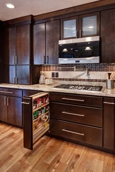 Modern Kitchen with One-wall, Millstead handscraped smoked maple natural solid hardwood flooring, Limestone Tile, Flush