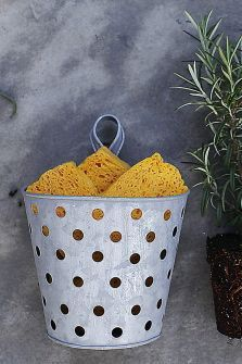 Metal basket is perfect for holding sponges to air dry.