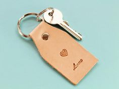 This handmade Live Love leather keyring would make an excellent leather gift for mom. This handcrafted leather keychain for women would also make an ideal best friend gift for a birthday. Also, handmade leather goods and accessories make great anniversary Leather Bookmark, Leather Keyring, Leather Gifts, Leather Craft, Handmade Leather, Leather Anniversary Gift, Great Anniversary Gifts, Gifts For Friends, Gifts For Mom